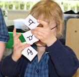 Child learning handwriting concepts through play, games and interactive activities